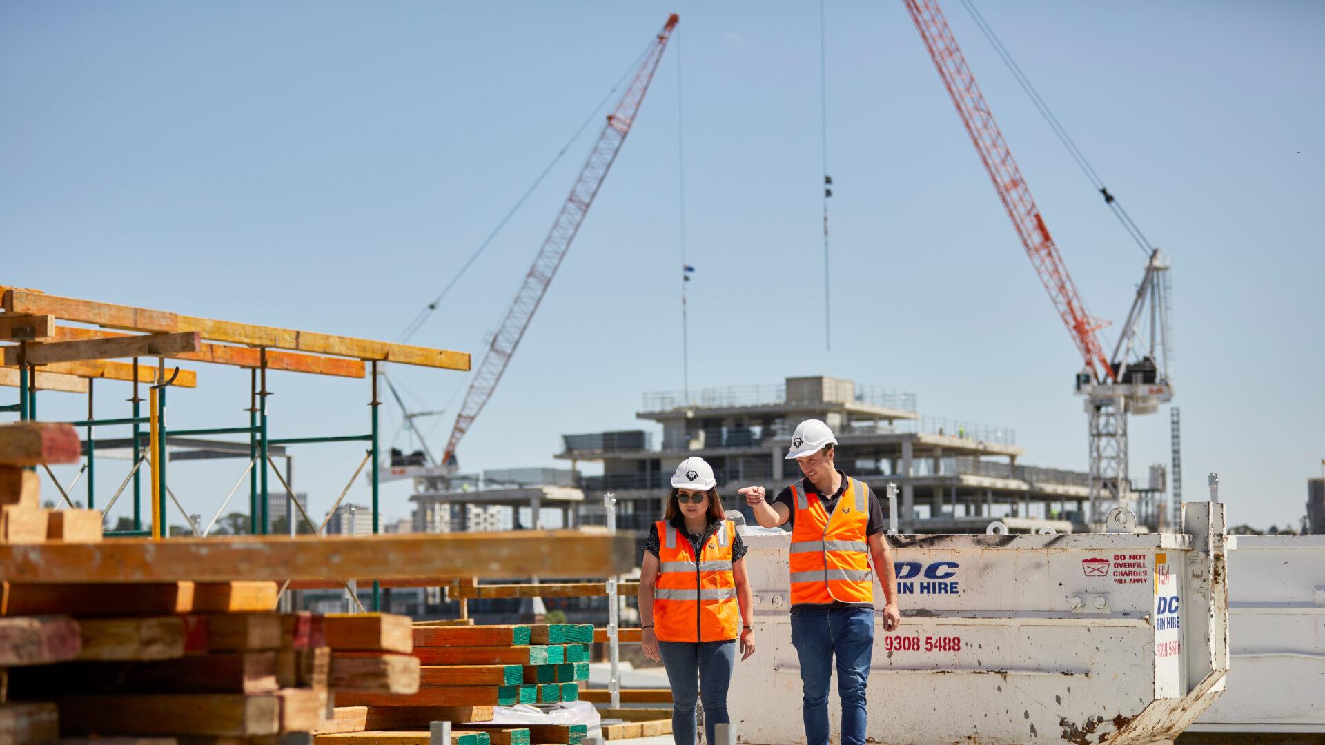 Woman Man Walking Construction Site Header